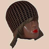 Женская вязаная зимняя шапка-ушанка с элементами кожи