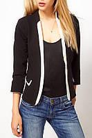 Женский черно-белый пиджак .