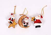 Елочная игрушка Дед Мороз сидящий на луне, на звезде, держит в руках звезду