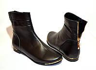 Ботинки кожаные зимние на плоской подошве.