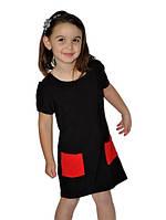 Детское платье черного цвета с красными карманами