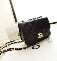 Клатчи-сумочки Chanel черная и белая