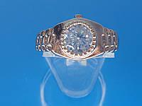 Кольцо «Часики» с устойчивым  покрытием золота розового оттенка и фианитом.