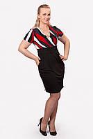 Яркое женское платье отлично  ложиться по фигуре