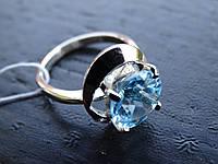 Кольцо серебряное с золотой вставкой и голубым топазом
