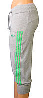 Капри спортивные женские (трикотаж) зеленые лампасы