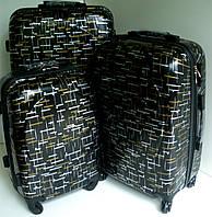 Чемодан дорожный на колесах, из поликарбоната, 50 см, черный с золотом и серебром.