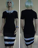 Облегающее черное платье с прозрачными белыми вставками из сеточки