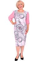 Очень красивое женское платье модного кроя с интересным принтом