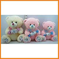 Музыкальный медведь с конфетой 30 см | Мягкие детские игрушки