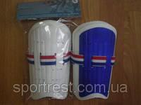 Щитки футбольные детские пластик.