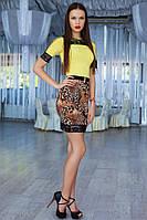 Эффектное женское платье с леопардовой юбкой