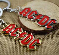 Брелок с логотипом  рок-группы AC / DC