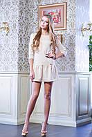 Очень милое женское платье с отрезной юбочкой в виде широкой оборки по низу. Рукав 3/4, круглая горловина.