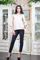 Оригинальная женская блуза из стеганного трикотажа с рукавом 3/4. В рельефы реглана вшит формованный кант из э