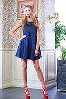 Стильное женское платье без рукавов с завышенной талией и объемной юбкой со встречными складками. Верх платья