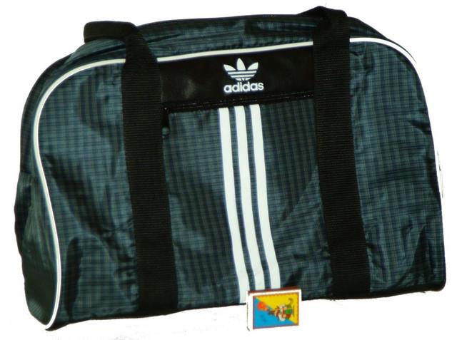 4cf358d8e558 Сумку можно носить через плече или в руке.Сумка высокого качества с  хорошими молниями. Рекомендую.