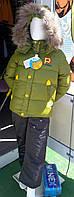 Зимний пуховый костюм зеленый с мехом