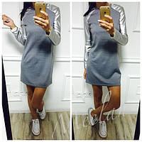 Женское платье с *кожаными* рукавами