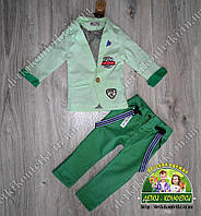 Стильный пиджак для мальчика зеленый с отворотами на рукавах