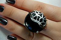 Серебряное кольцо с ониксом и золотыми вставками