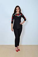 Праздничная женская вышиванка черного цвета с ярким цветочным орнаментом