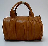 Сумка женская, коричневая, цилиндрической формы.