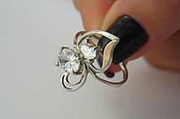 Женское серебряное кольцо с фианитами и золотом
