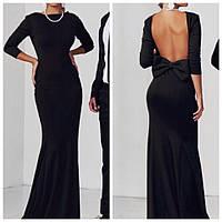 Платье трикотажное в пол черного цвета с открытой спиной и бантом