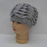 Серая вязанная женская шапка на зиму 2016
