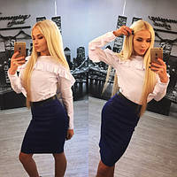 Женский красивый костюм: блуза и юбка с кожаными вставками