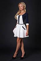 Красивое женское платье с декоративной молнией и вставки из кожи