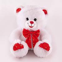 Игрушка мягкая музыкальная Медведь белый с красным бантом 20 см