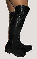 Зимние кожаные ботфорты на толстой подошве