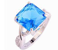 Кольцо с голубым топазом,покрытое серебром р 17,18,19,20 код 825
