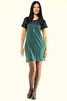 Свободное женское платье с коротким рукавом с карманами из вискозы.