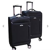 Элитный чемодан на колесиках двойка .