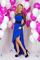 Женское вечернее платье синего цвета асимметричного кроя.