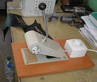Пристрій для гарячого тиснення на шкірі через фольгу