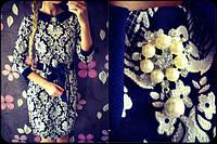 Модное женское платье с украшением из жемчуга