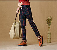 Креативные женские брюки в клетку