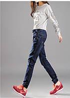 Оригинальные джинсы на резинке внизу