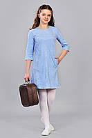 Строгое подростковое платье с прорезными карманами