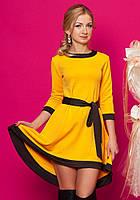 Женское нарядное платье желтого цвета с рукавом три четверти.