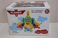 Музыкальная игрушка самолет пластмасса на батарейках в коробке для детей