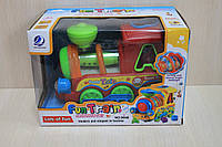 Музыкальная игрушка паровоз пластик на батарейках в коробке для детей 12+