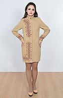 Красивое женское пальто бежевого цвета