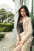 Стильный пиджак прямого силуэта с высоким воротником-стойкой, по бокам расположены карманы, 42-52 размеры