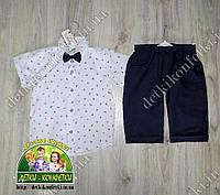 Нарядный летний костюм для мальчика: белая рубашка с бабочкой и темно-синие шорты