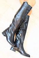 Стильные женские сапоги из натуральной кожи черные на низком каблуке.